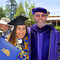Masters in Counseling professor and student posing for a photo at graduation at Palo Alto University in Palo Alto, CA