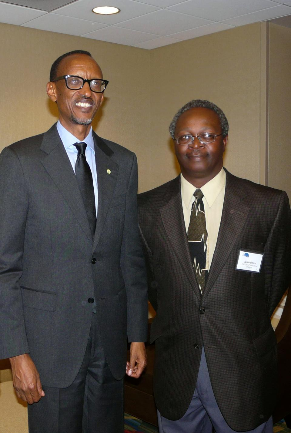James Otieno with Rwandan President Paul Kagame