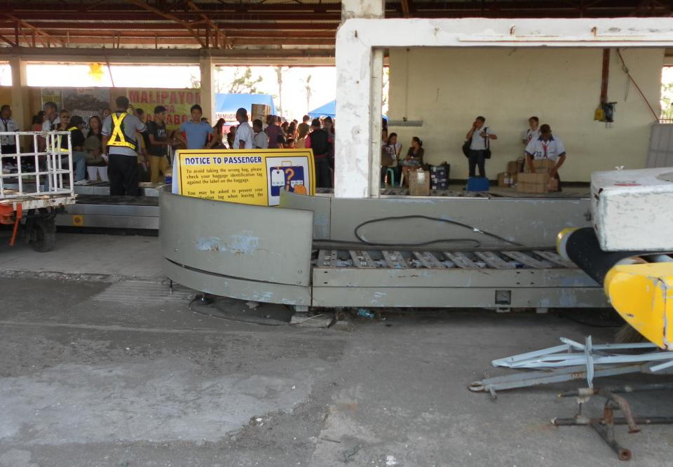 Baggage claim, Tacolban airport. This airport had no running water and little electrical generator power