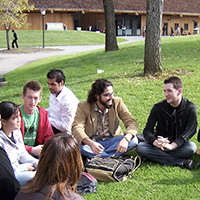 Undergraduate psychology students gather for an outdoor class on campus
