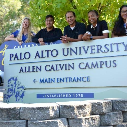 students in front of PAU sign